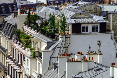 mezzanine: Paris roofs panoramic overview at summer day, France, traditional postcard picture Stock Photo