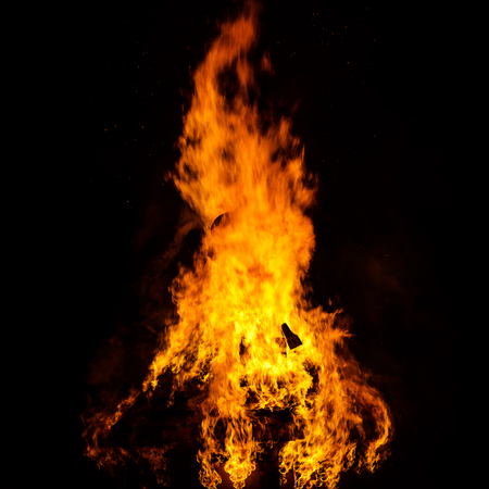 heat loss: Wooden house roof in fire  on black background, dengerous concept