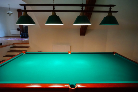 snooker rooms: Green billiard table in private apartment with lamps over it