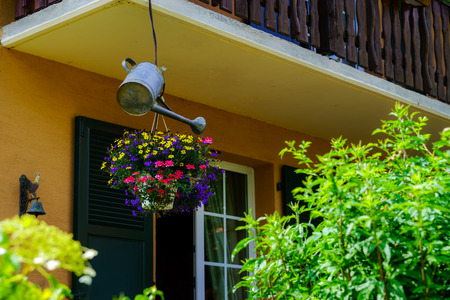 watering pot: House decoration by flowers and watering pot, France