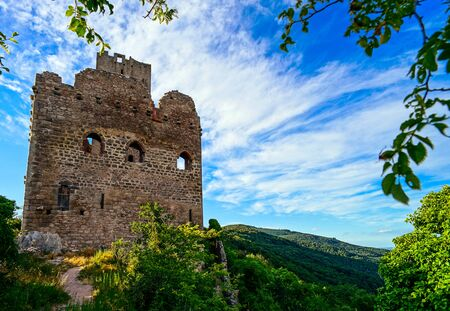 broken hill: Majestic medieval castle ruins on the top of the hill, Ortenbourg, Alsace, France Stock Photo
