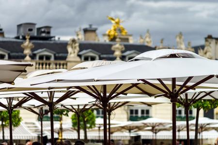 sun umbrellas: Sun umbrellas of the street cafe in Nancy, France Stock Photo