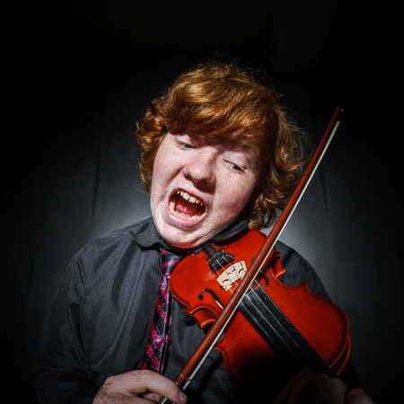 laughable: Studio shooting. Fisheye disfigured. Making face.. Rock style. Stock Photo