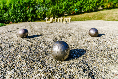 french boule: Metal balls for petanque on the ground, perspective view