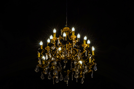 electrolier: Crystal chandelier lighting in the big majestic hall, old-style