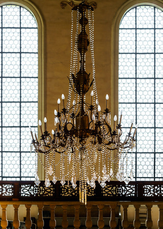 Crystal chandelier lighting in the big majestic hall, old-style