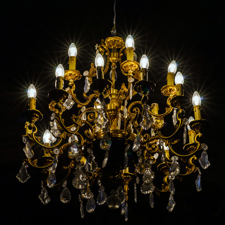 oldstyle: Crystal chandelier lighting in the big majestic hall, old-style