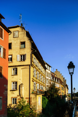colorized: Classic colorized timber-framed alsacien houses in the street of Little France, Strasbourg, touristic concept