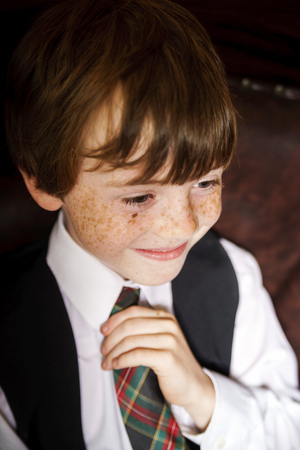Emotive portrait of red-haired freckled boy, actor portfolio, childhood concept Stock Photo