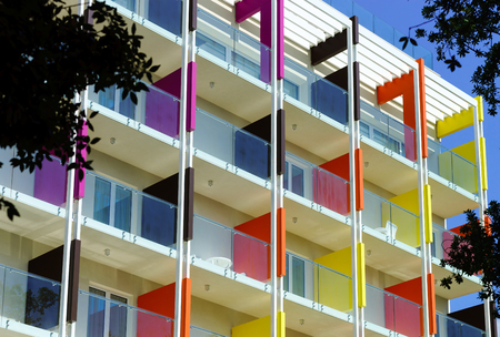 fasade: Beautiful colorful fasade of new hotel on sea resort. Touristic concept
