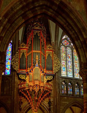 Majestic Strasbourg cathedral interior, golden decor, France