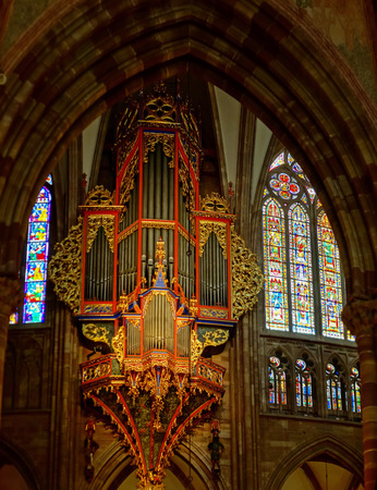 Majestic Strasbourg cathedral interior, golden decor, France