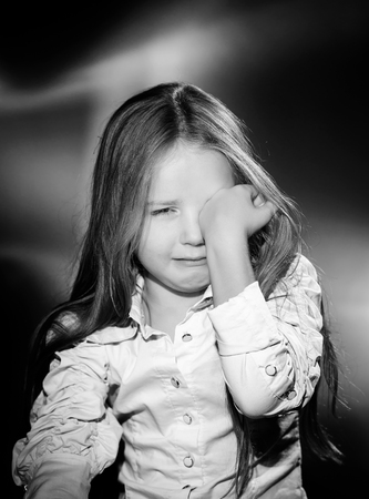 Cute little girl with long hair crying, black and white Stock Photo
