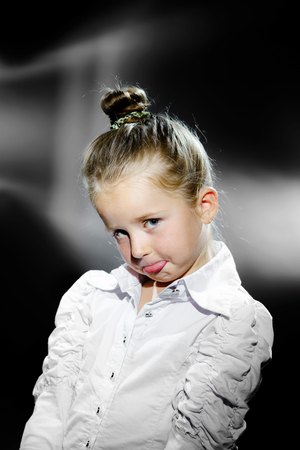 Emotional portrait of cute little girl in vintage style Stock Photo