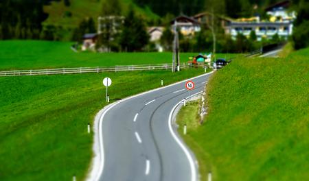 Alpine countryside road in green fields, Austria