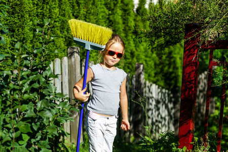 helpmate: Cute little girl helping mother in the garden, summer day Stock Photo