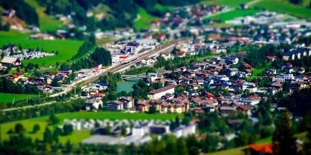 Tilt-shift aerial view of little austrian city in the valley, Austria, summer Stock Photo