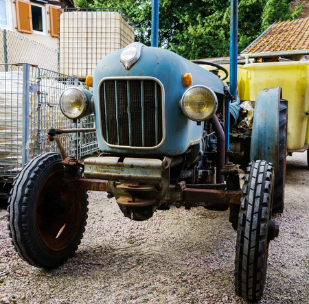 Funny vintage tractor on the farm, countryside concept Stock Photo