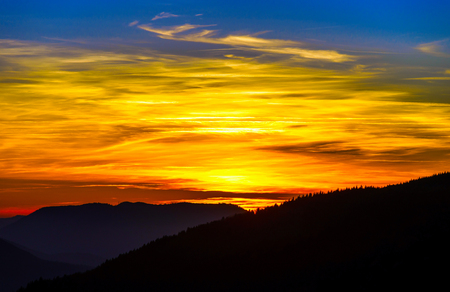 Idyllic sunset landscape with silhouettes of mountains and vivid colors, Vosges, Alsace, France