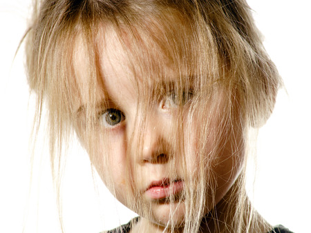 Disheveled preschooler girl with long hair portrait, isolated on white background