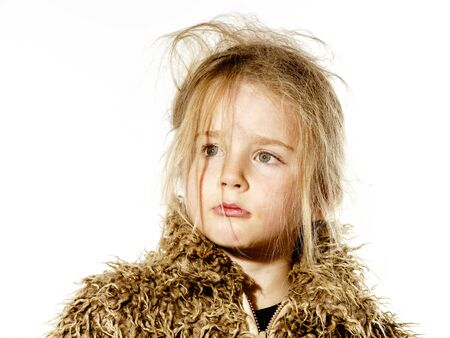 uncombed: Disheveled preschooler girl with long hair dressed in fur coat, isolated on white background