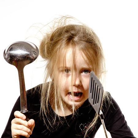 Disheveled preschooler girl with soup ladle, isolated on white background Stock Photo