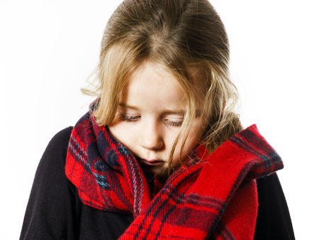 Cute little girl dressing by red comfort scarf, isolated on white background Stock Photo