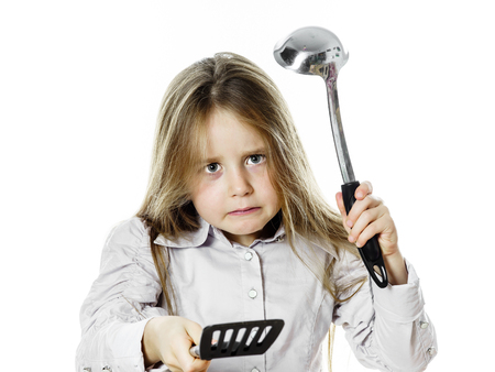 playing with spoon: Angry little girl with soup ladle, isolated on white background Stock Photo