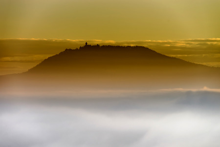 tranquillity: Majestic fog ocean in the mountains on sunset, Alsace, France Stock Photo
