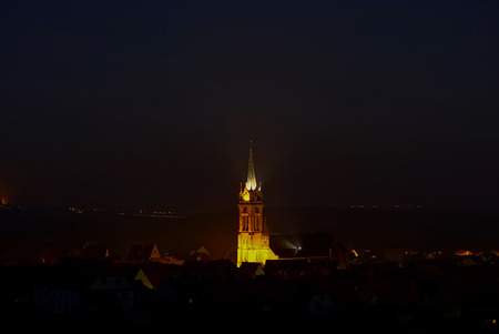 belltower: Majestic highlighted belltower of old  cathedral night view, Dambach-la-ville, Alsace, FGrance