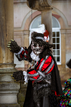 harlequin clown in disguise: Editorial, 4 March 2017: Rosheim, France: Venetian Carnival Mask - most beautiful masks photographed in open street
