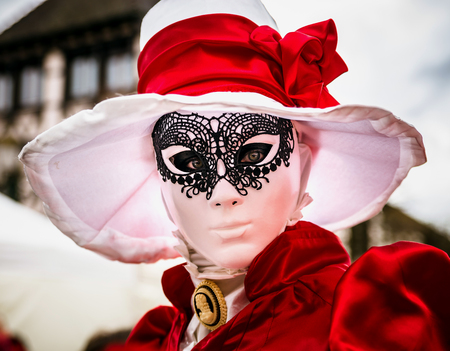harlequin clown in disguise: 4 March 2017: Rosheim, France: Venetian Carnival Mask - most beautiful masks photographed in open street Editorial