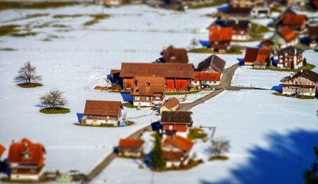 Miniature tilt-shift aerial view of the village in Alps, Switzerland