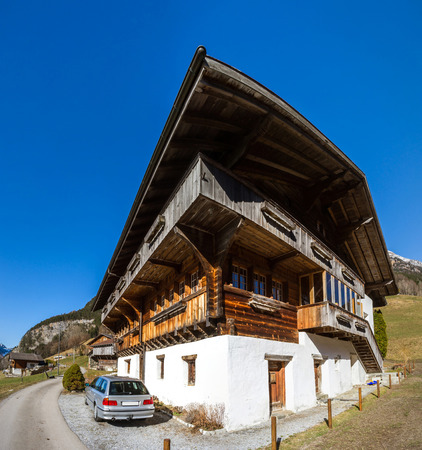 alpen: Typical alpine house. Switzerland. Wide-angle HD-quality panoramic view. Stock Photo
