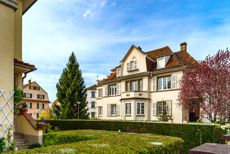 Classic french house in residential district of Strasbourg, blossom spring time, flowering and gardening. France. Stock Photo