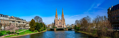 Panoramic view of beautiful church in Strasbourg from the river side