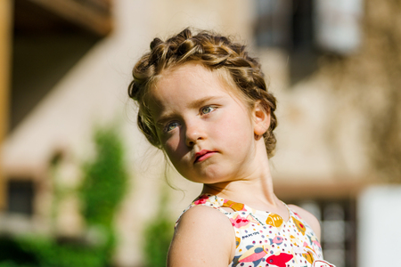 bunches: Cute little preschooler girl natural portrait on the sun, hairdress bunches style, children fashion Stock Photo