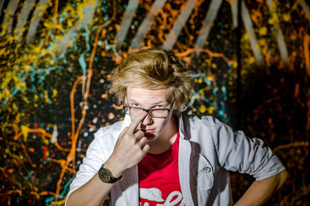 Funny teenage boy posing like a crazy professor or student, expressive person