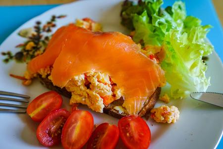 Tasty morning breakfast, omelet, salade, salmon and tomates, natural food Banco de Imagens