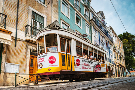 Editorial: 8th June 2017: Lisbon, Portugal:  Classical colorized touristic tram on the street, perspective view.