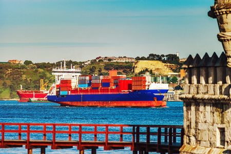 commerce and industry: Cargo ship near the Belem tower, Lisbon, Portugal