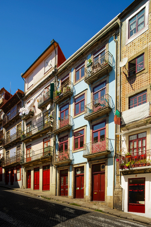 Colorful decorated facades of traditional portugal street, sunny and vivid colors