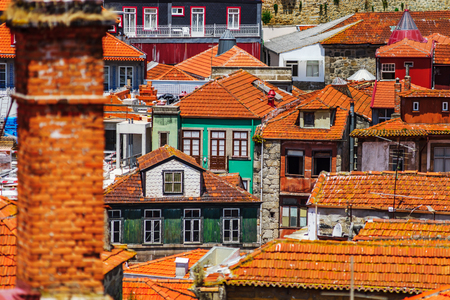 Colorful miniature tilt-shift view of old historical city center, Porto, Portugal