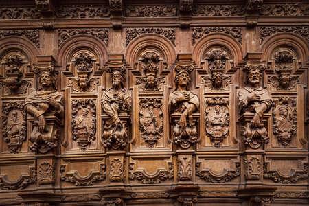 Genial wooden engraved silhouettes and faces in old Abbey Floreffe, Belgium