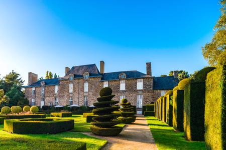Regular garden in little french castle, sunset time, France