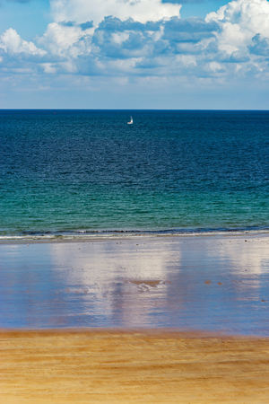 Low tide water on coastline, yellow sand of the beach, Bretagne, France Stock Photo