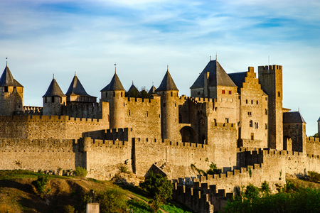 Carcassonne medieval fortress sunset view, warm light, France Imagens