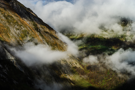 Over the clouds in high mountains, Pyrenees, foggy and cloudy, France