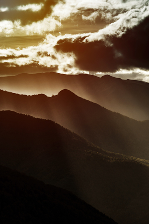 Sun rays lighting through the clouds in high Pyrenees, France Banco de Imagens