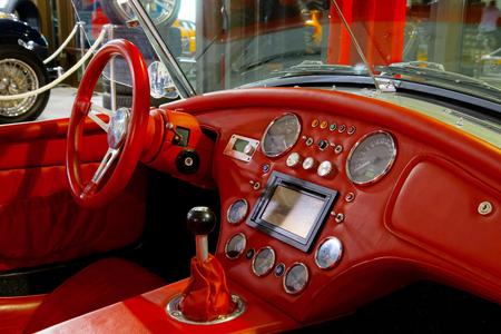 Vivid red skin interior of old retro car, vintage design
